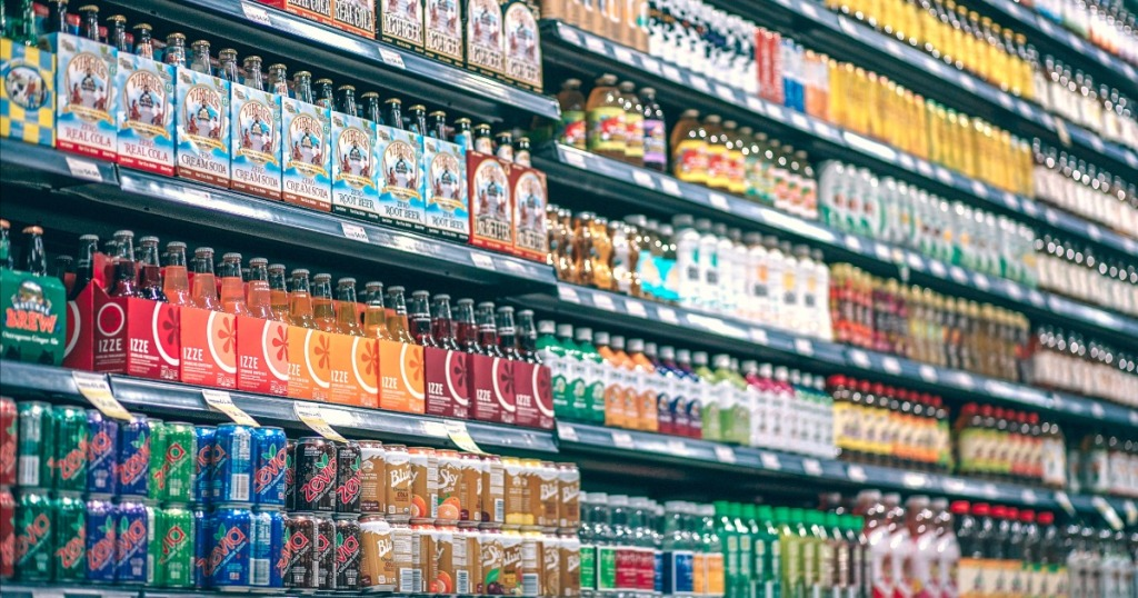 how to read nutrition labels — bottles on shelf at store