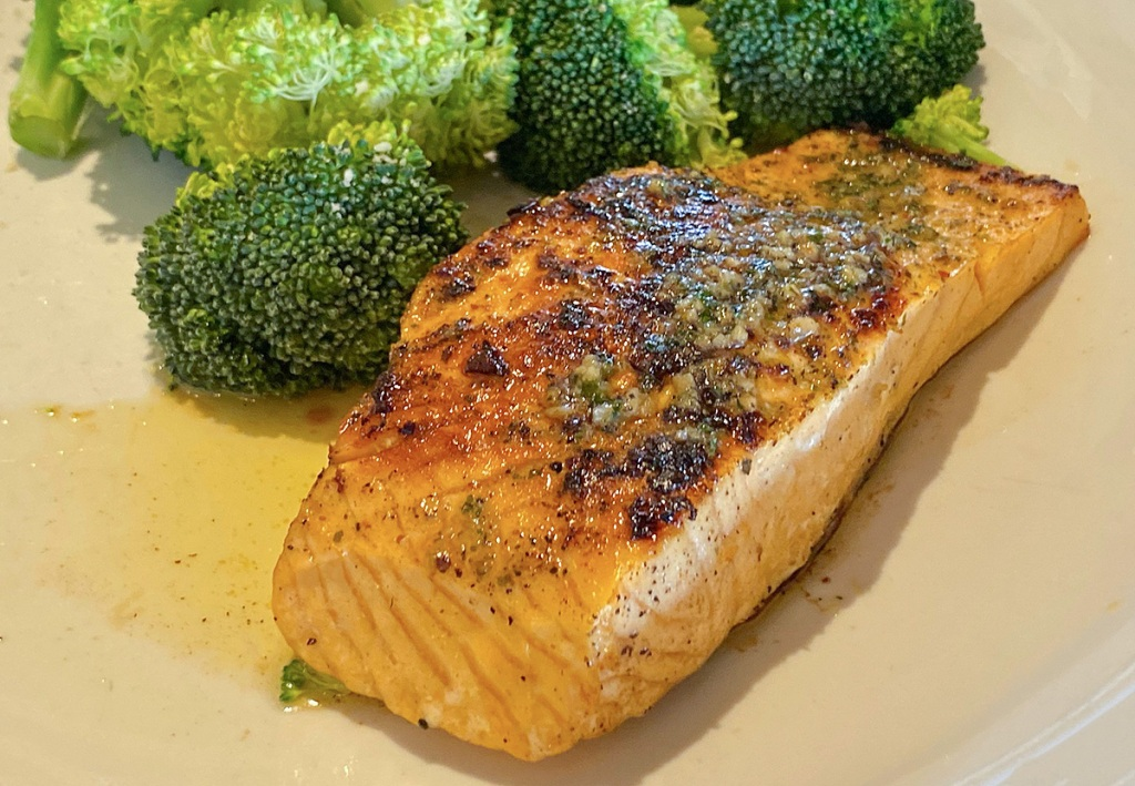 grilled salmon on a plate with broccoli