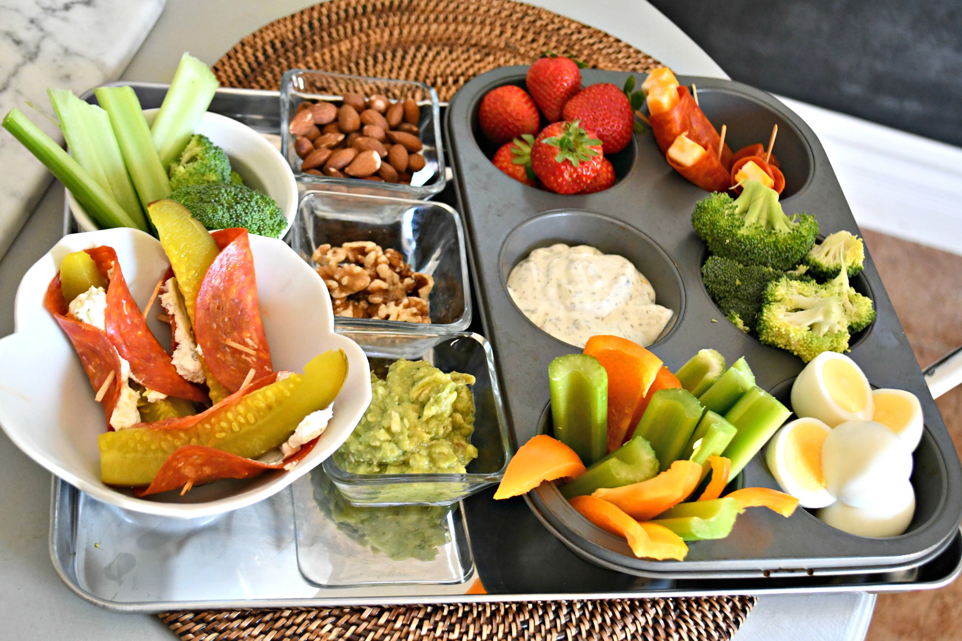 a tray filled with keto finger foods like fruits, veggies, meat, and cheese