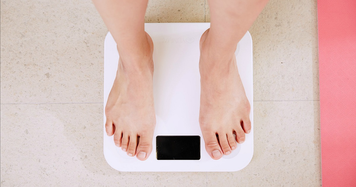 woman standing on scale waiting for weight