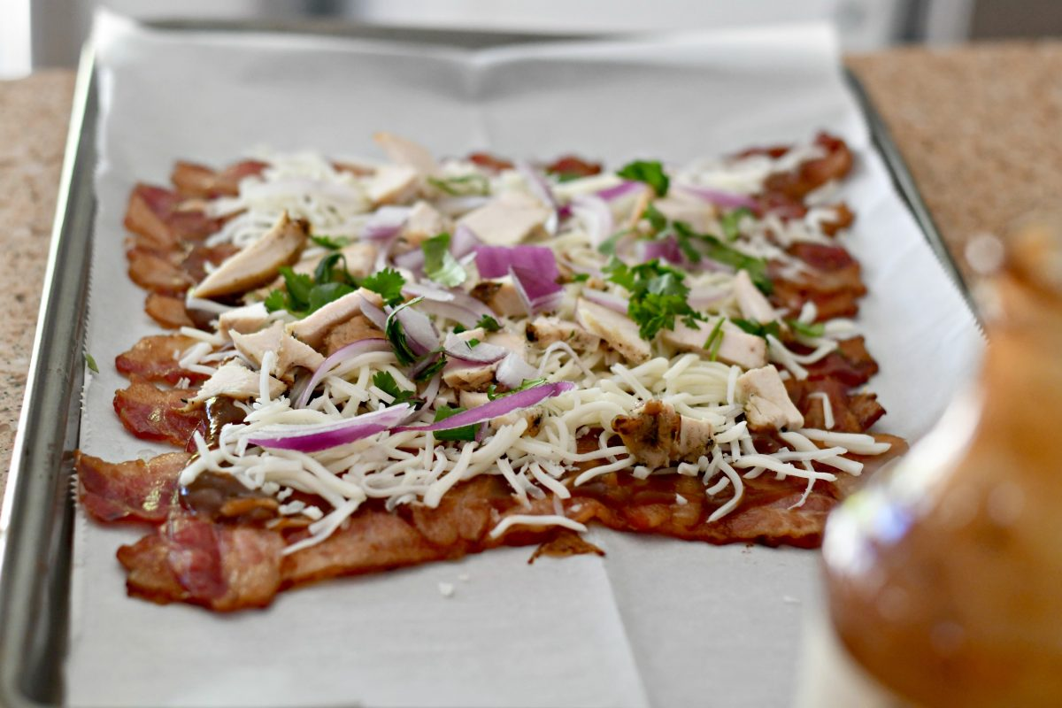 Keto BBQ Chicken Bacon Weave Pizza – topping the cooked bacon with ingredients