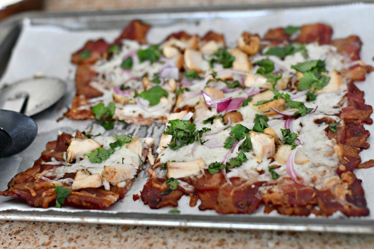 Keto BBQ Chicken Bacon Weave Pizza – cutting the bacon after cooking
