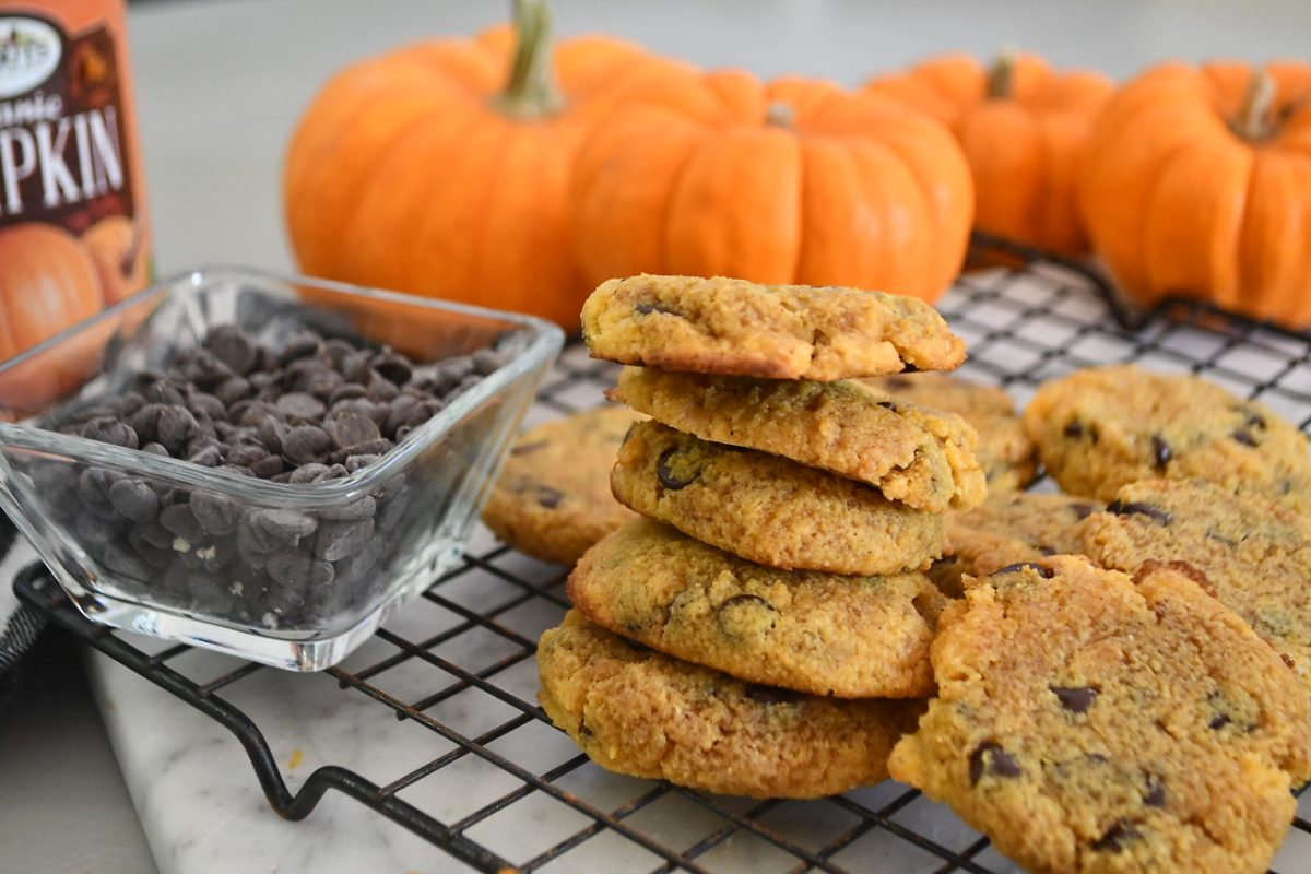 Keto Pumpkin Chocolate Chip Cookies stacked on a cooling rack