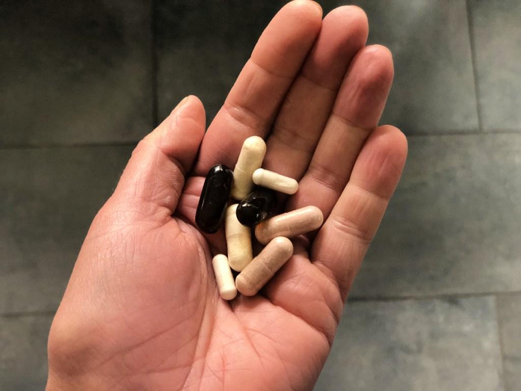 best keto supplements - handful of supplements