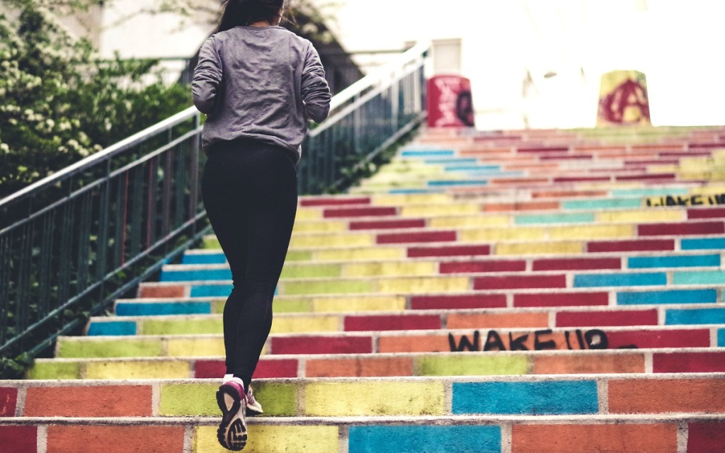 keto and exercise — woman running up stairs with endurance