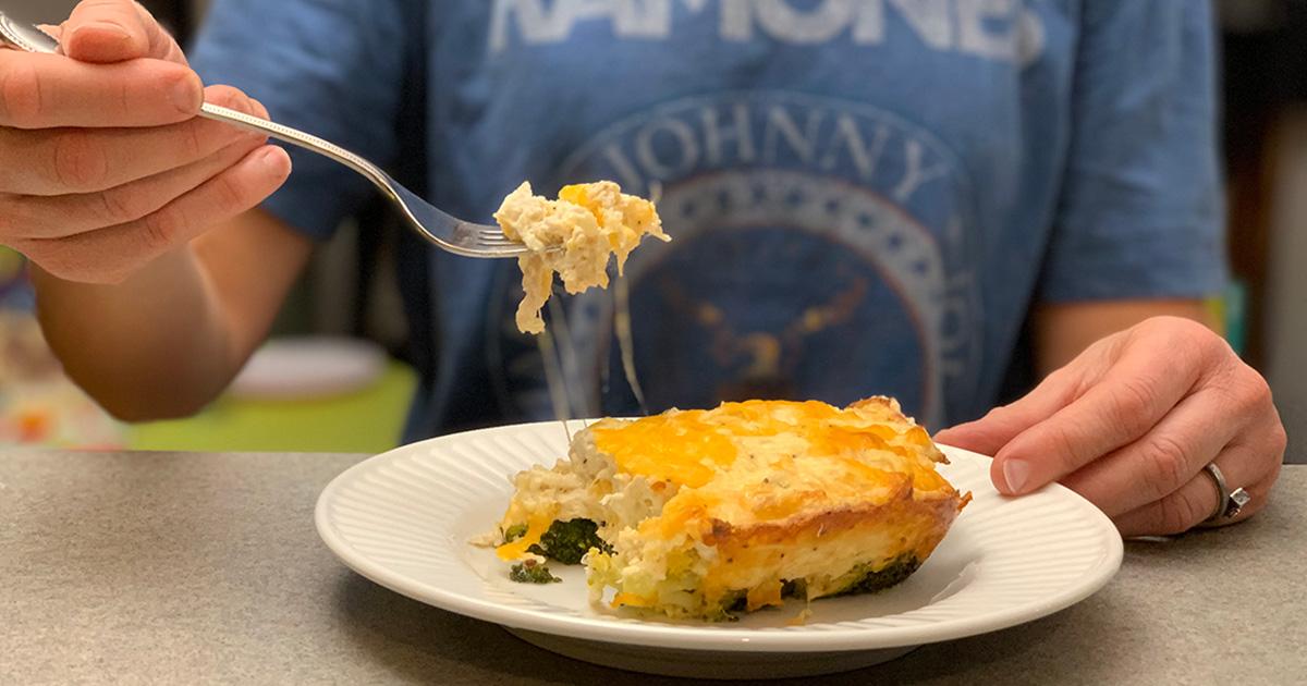 keto chicken broccoli cheese casserole – person taking a bite