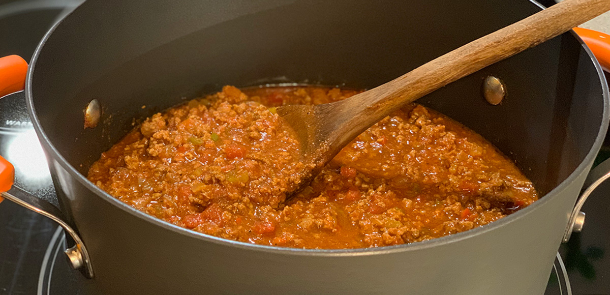 Wendys Chili Copycat Keto Recipe - stirring a big pot of chili