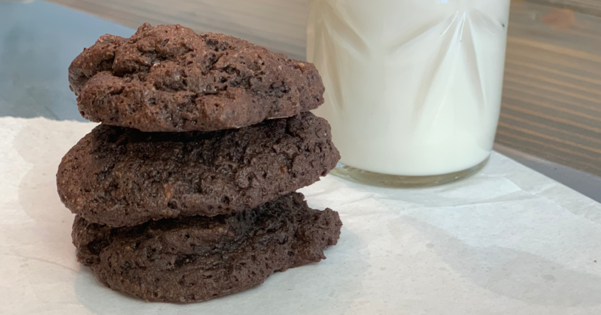 keto chocolate brownie cloud cookies – a stack of cookies with a glass of milk
