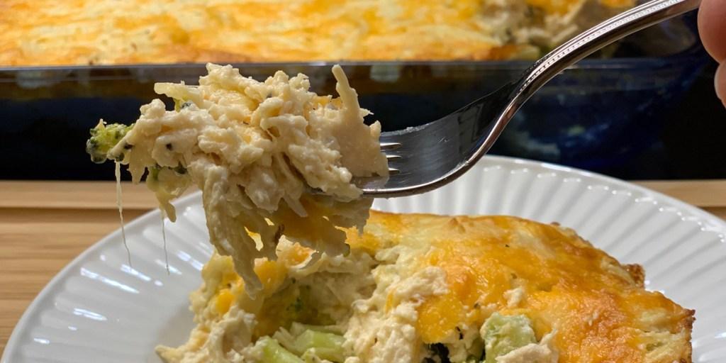 keto chicken cheese broccoli casserole - a fork with a big cheesy bite