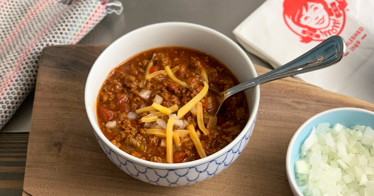 Wendys Chili Keto Copycat Recipe - bowl of keto chili with onion and cheese