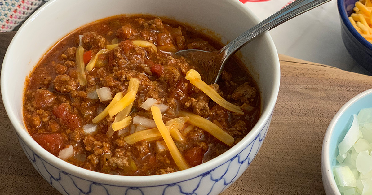 Wendy's Chili Copycat Keto Recipe - close up image of chili with onions and cheese