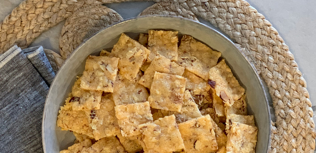 Crispy Low-Carb Parmesan Nut Crackers- A large serving bowl of crispy keto crackers