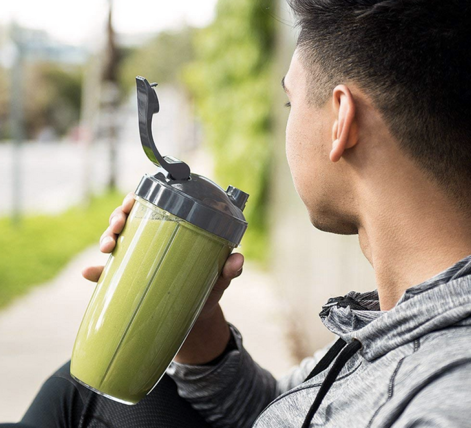 Man drinking a smoothie from the NutriBullet Pro