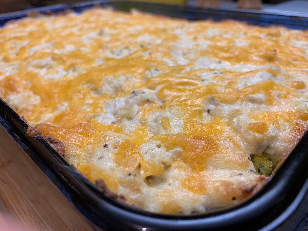 close up of keto chicken casserole with melted cheese on top