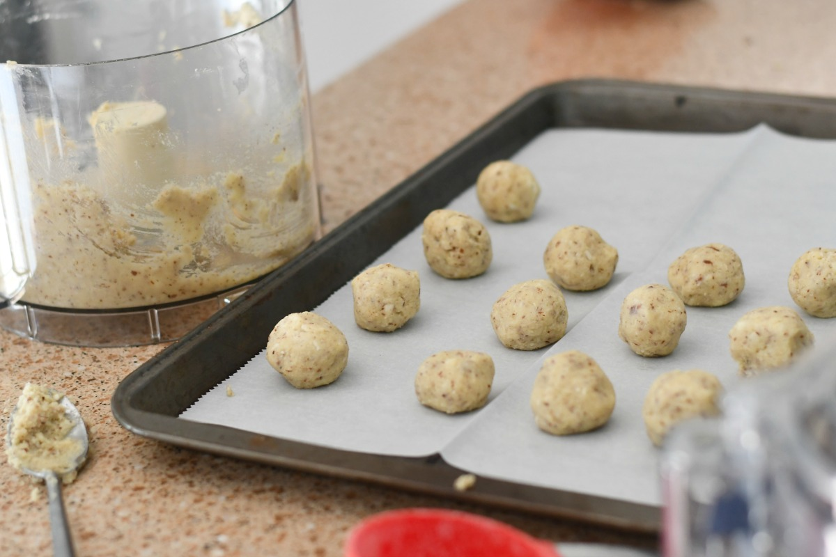 sugar-free snowball mexican wedding cookies – cookies on a parchment-lined baking sheet