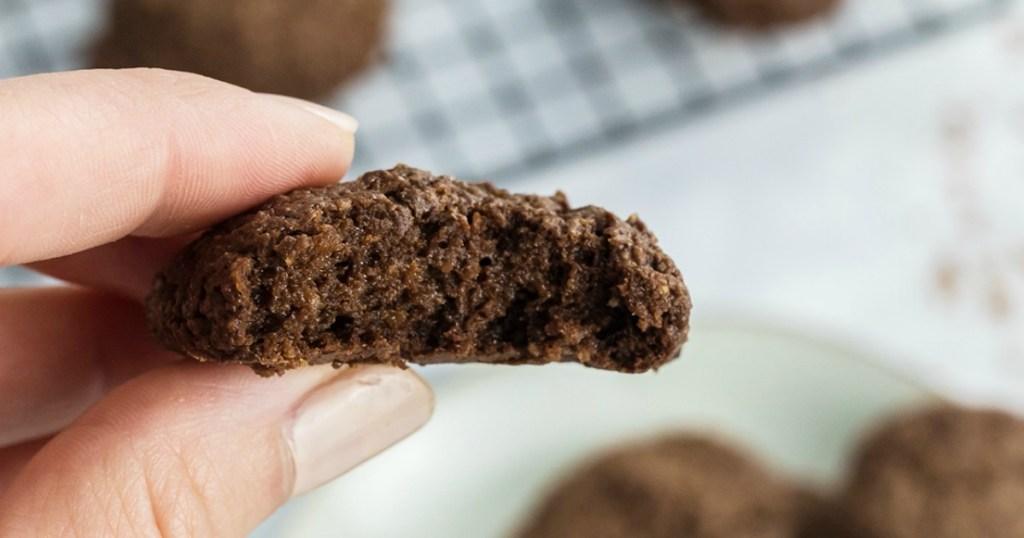 holding keto chocolate brownie cookie