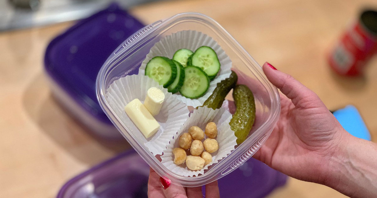 keto snack box with cucumbers, string cheese, macadamia nuts, and pickles