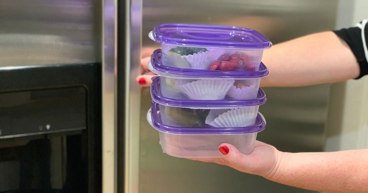make-ahead keto snack boxes – containers stacked and going into the fridge