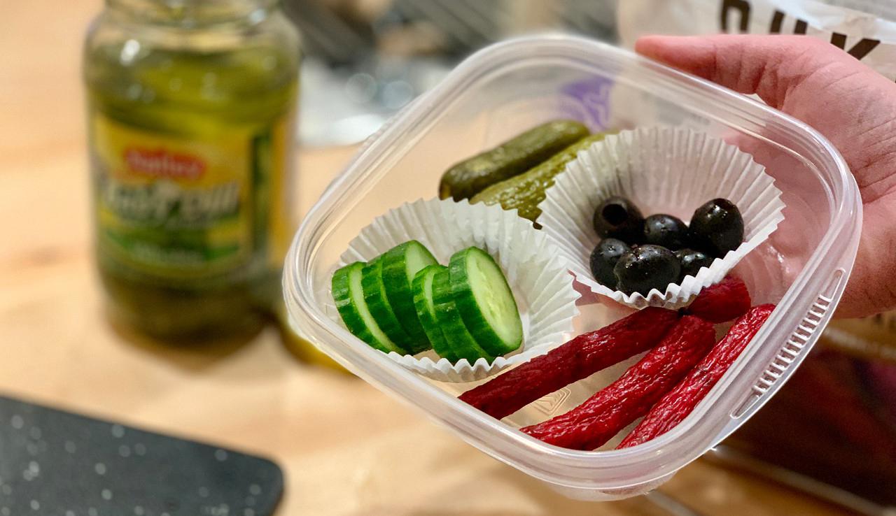 make-ahead keto snack boxes – slim jims, black olives, pickles, cucumbers