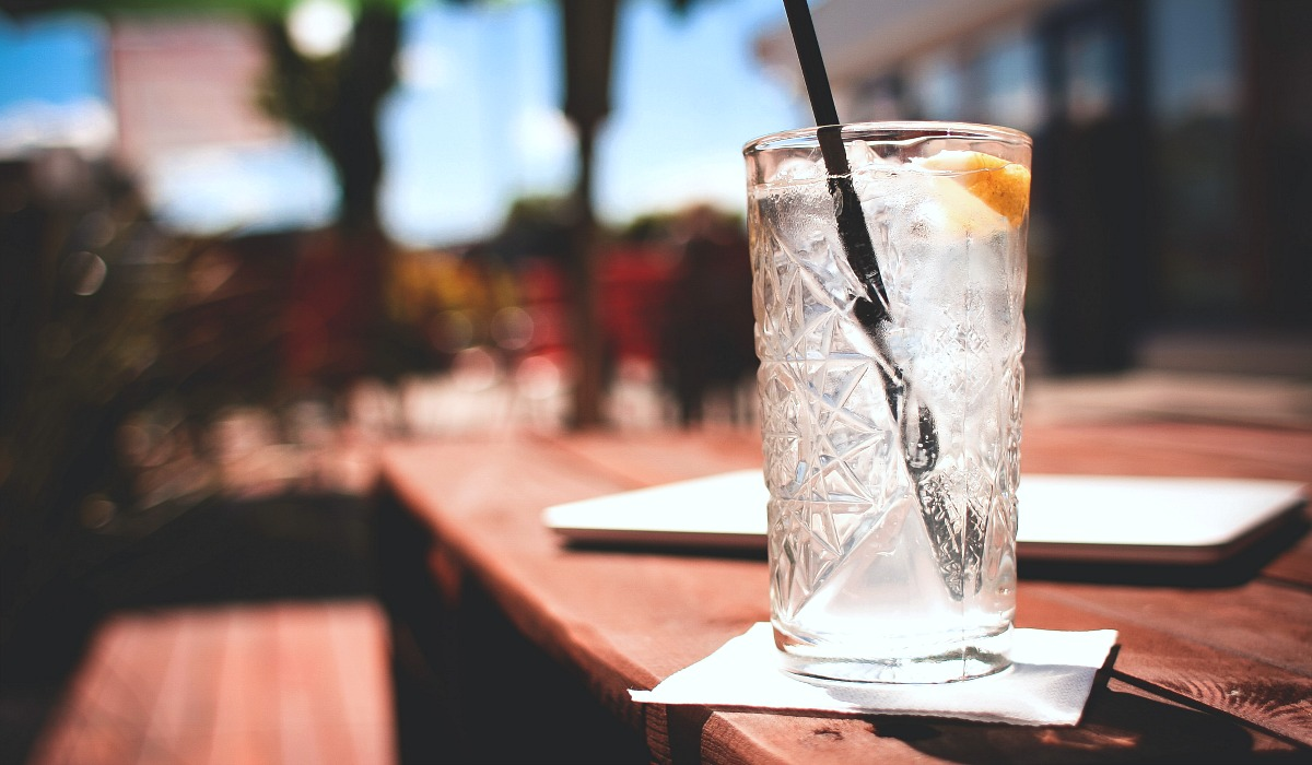 eating keto at restaurants — order water over sweetened drinks