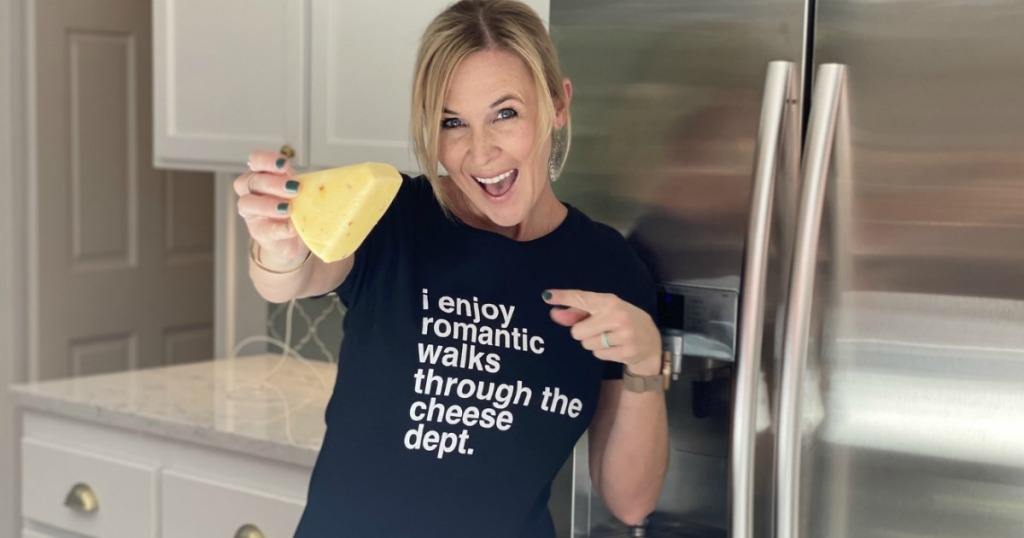 woman pointing at cheese block