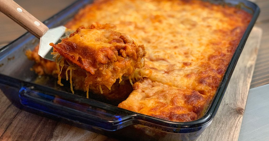 Keto Italian Sausage and Spaghetti Squash Casserole - large serving of casserole being scooped out of hot pan
