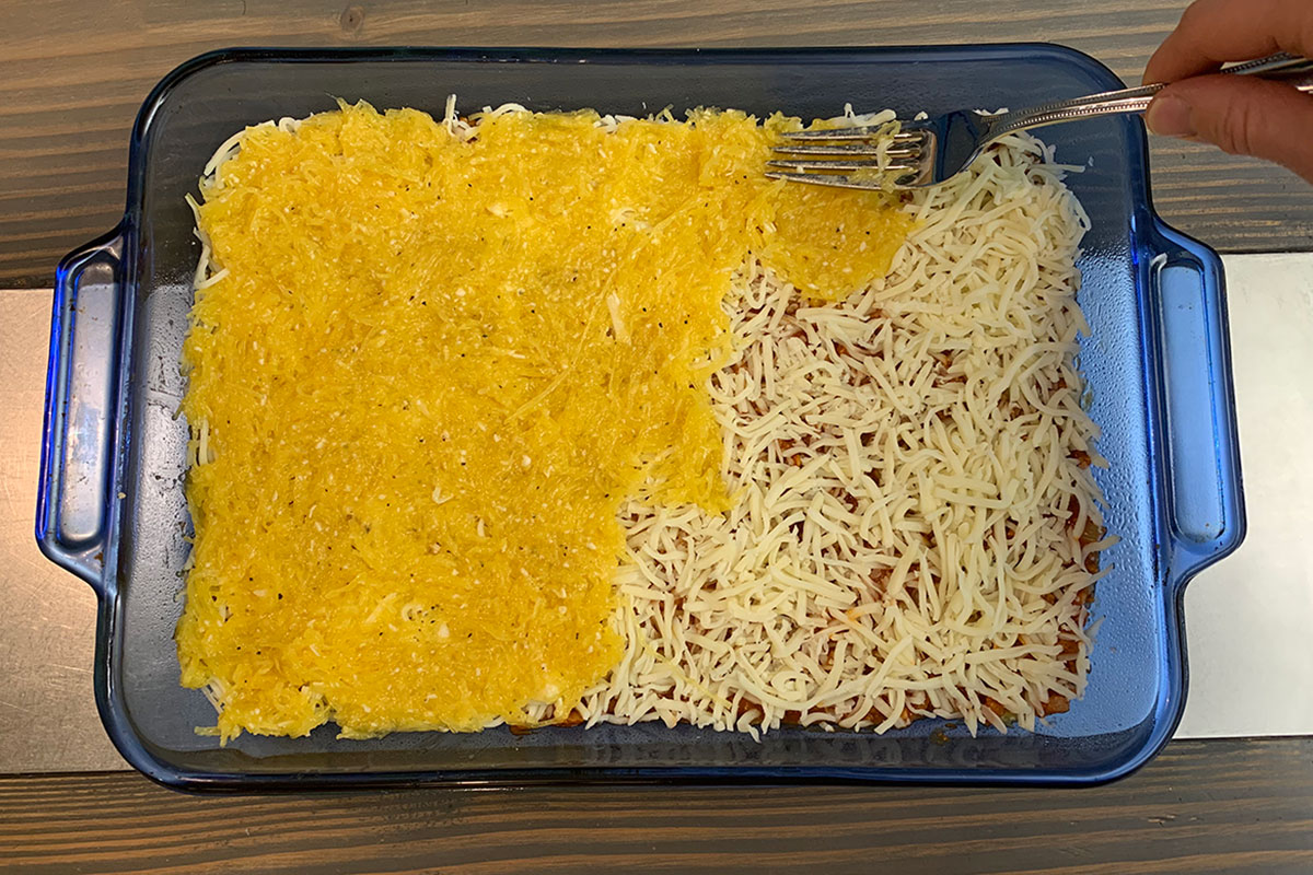 Keto Italian Sausage and Spaghetti Squash Casserole - adding ingredients to the baking dish