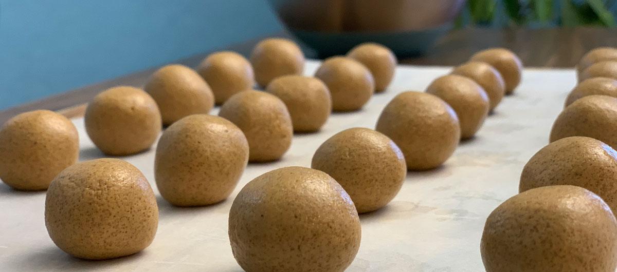 keto skippy p.b. bites recipe – balls rolled out on a pan