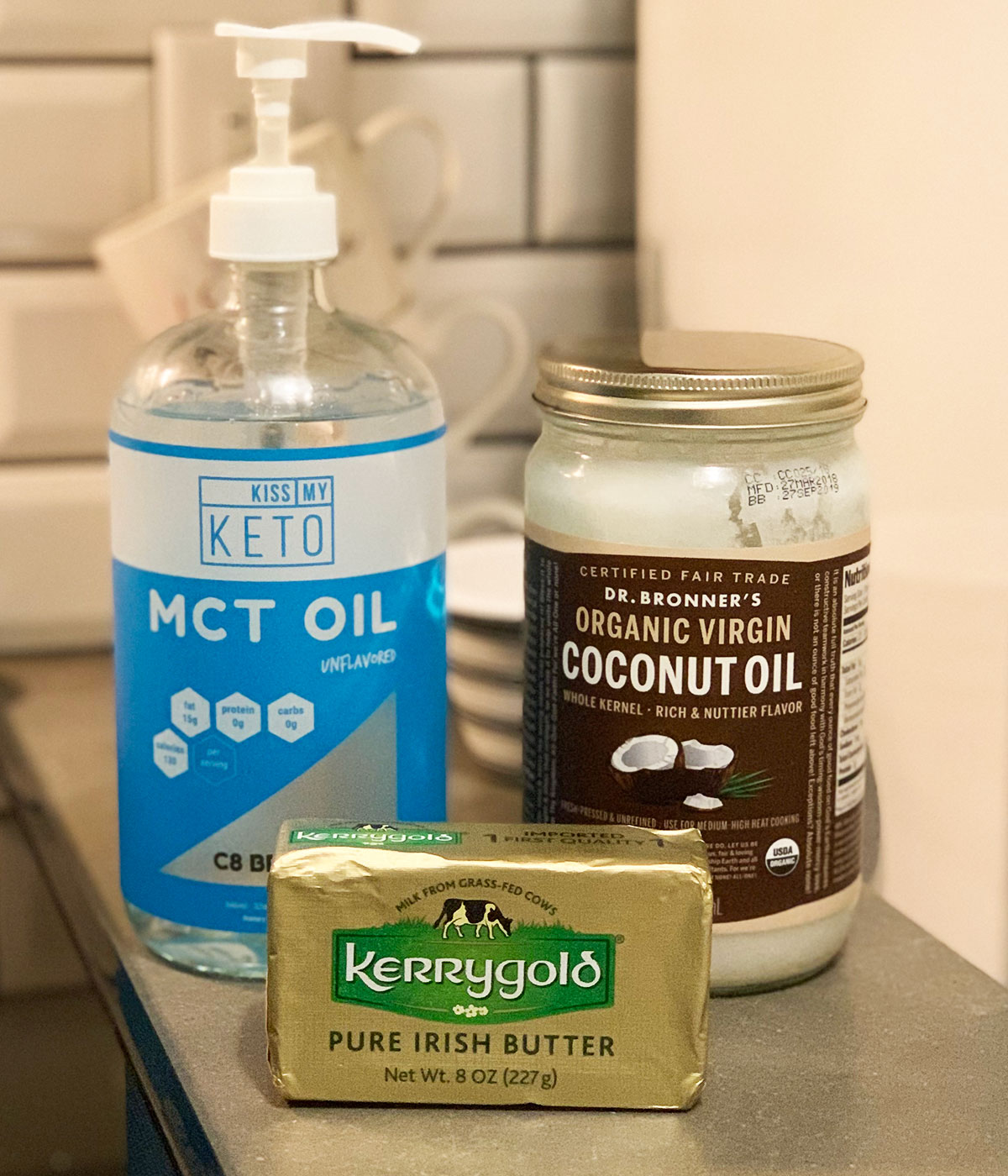 MCT oil and coconut oil, alongside Kerrygold butter