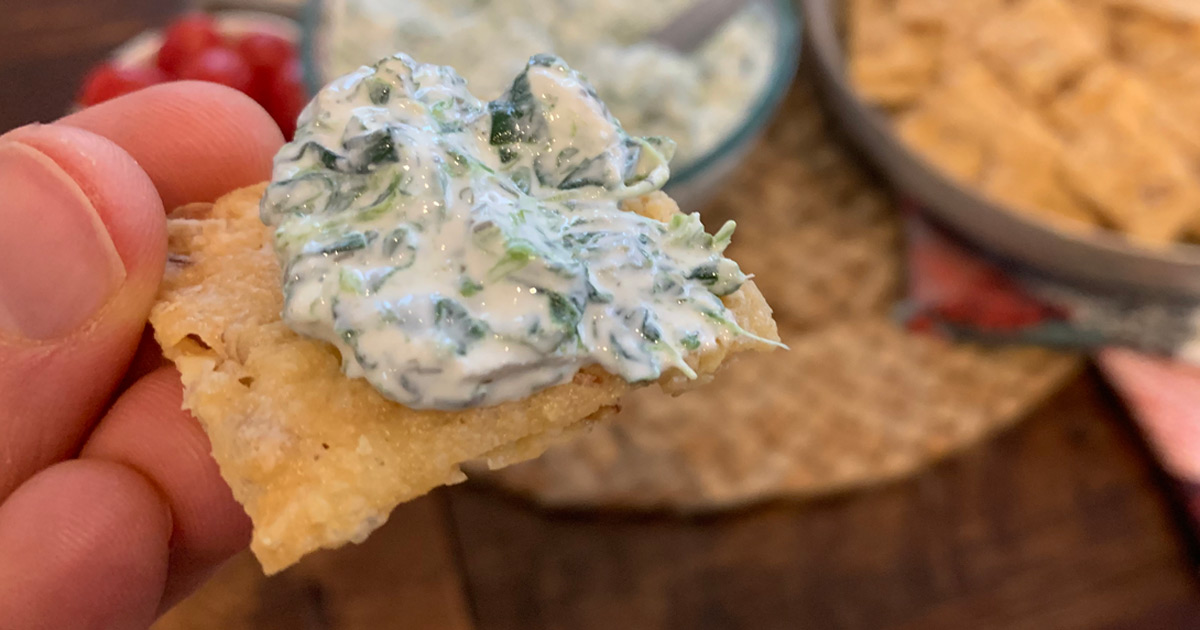 Game Night Keto Spinach Dip - spinach dip smothered on a cracker