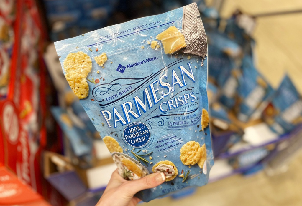 hand holding bag of Sam's Club Member's Mark Parmesan Crisps