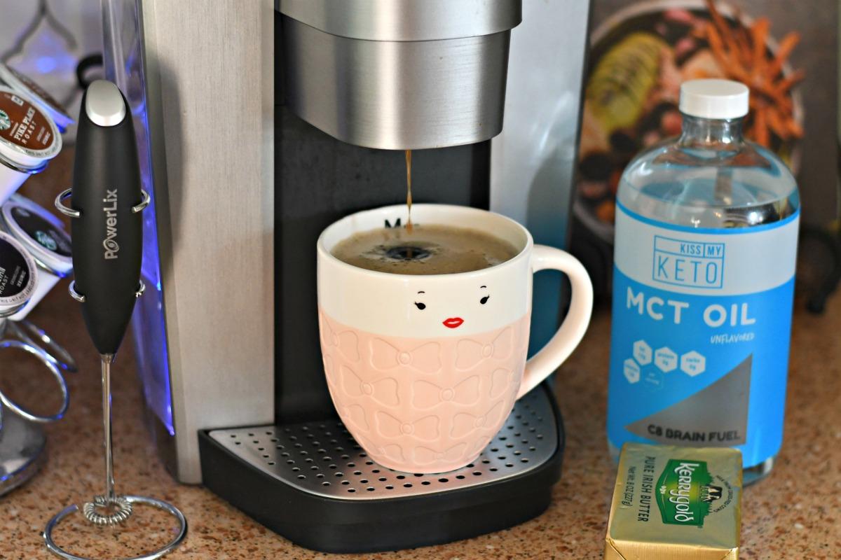 bulletproof coffee keto drink – mug of coffee being brewed into a cup