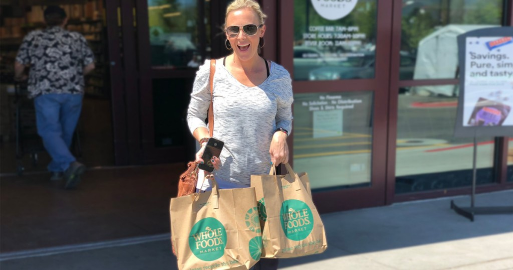 Collin carrying Whole Foods Bags