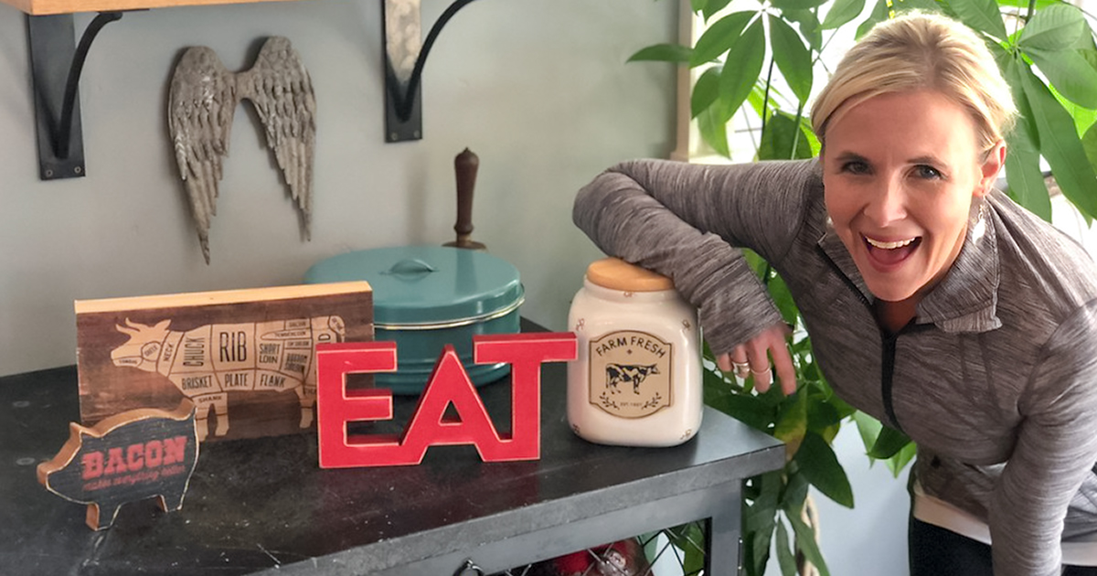 collin next to signs and kitchen accessories that say bacon and eat
