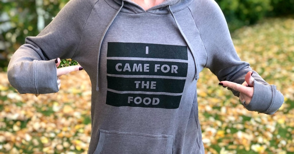 "Woman wearing hoodie that reads ""I came for the food"""