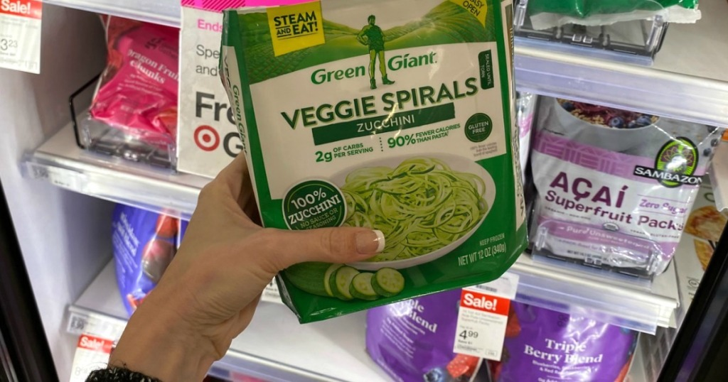 holding bag of Green Giant veggie spirals at Target