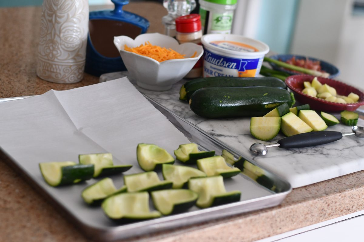 keto loaded zucchini skins recipe ingredients on the counter