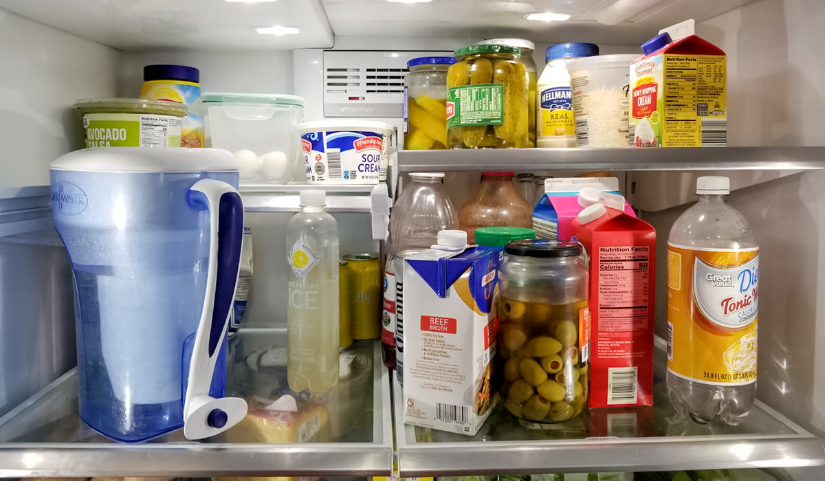 keto and low-carb foods include this fridge filled with olives, chicken broth, cream, and cheese