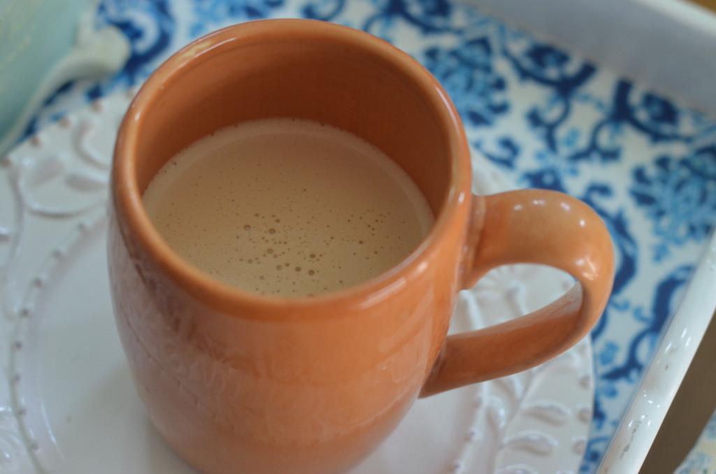 coffee mug with coffee and creamer