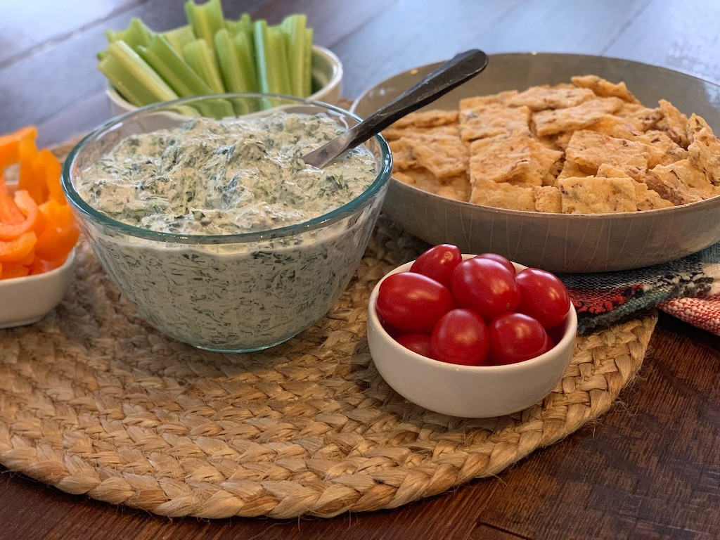 keto spinach dip with cucumbers, tomatoes and low-carb crackers