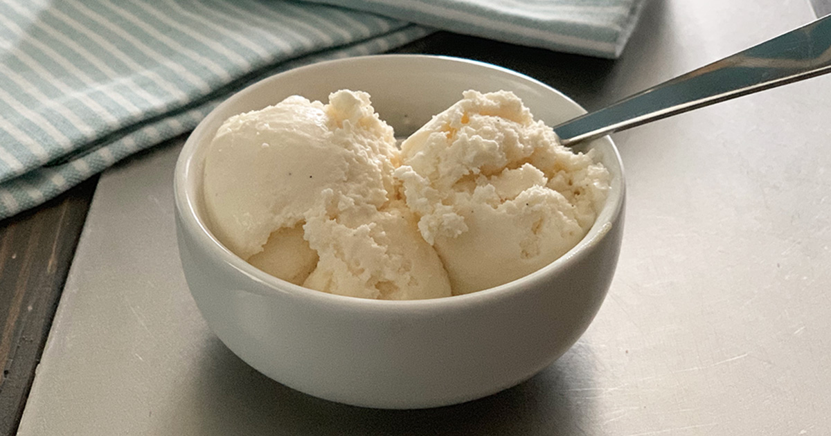Keto Low-Carb Vanilla Bean Ice Cream Recipe - a dish with two scoops of yummy ice cream