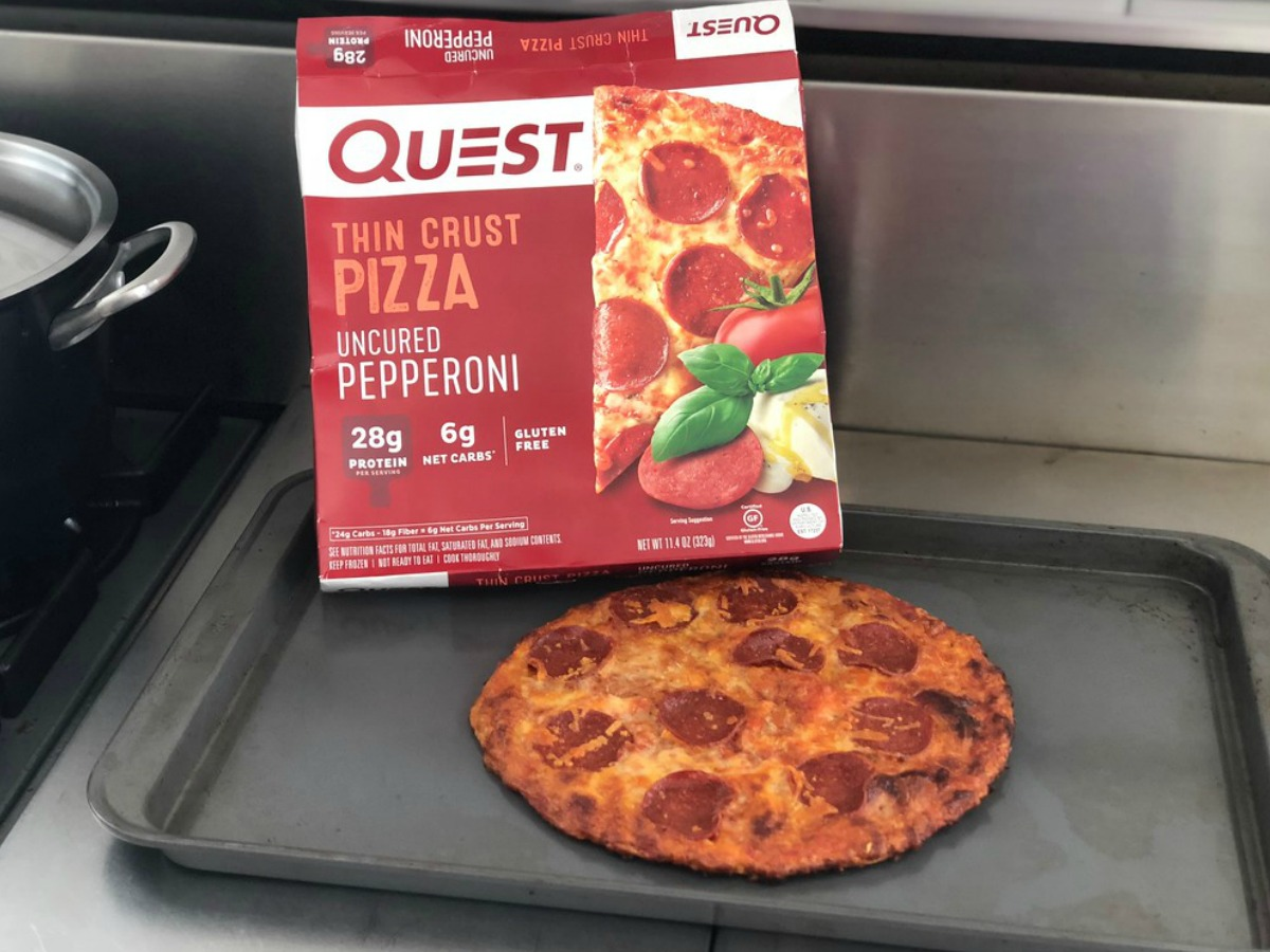 Quest pizza box next to a cooked pizza