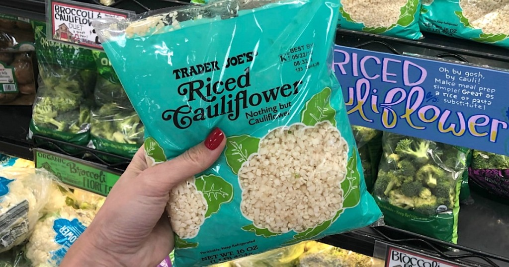holding bag of Trader Joe's riced cauliflower
