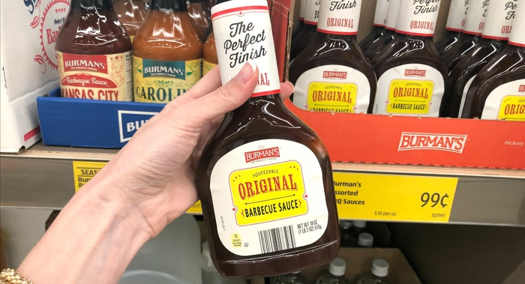 holding up barbecue sauce bottle