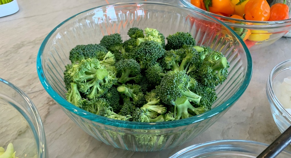 chopped broccoli in glass bowl
