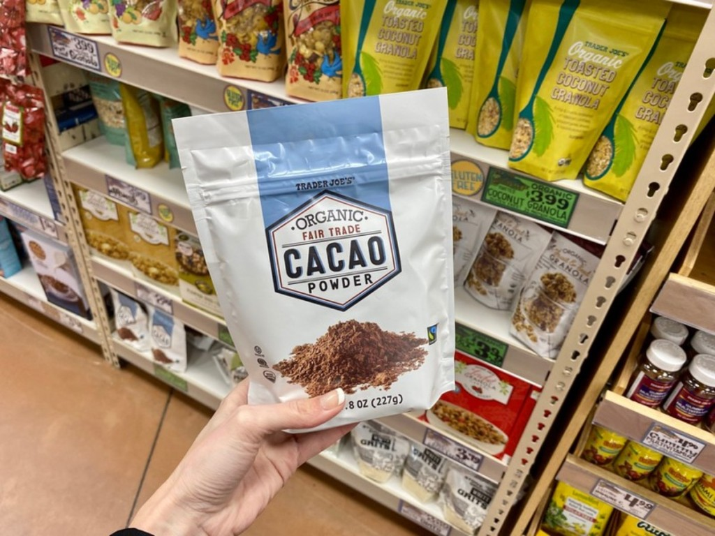 holding cacao powder at Trader Joe's