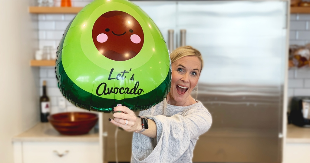 collin holding up avocado shaped balloon
