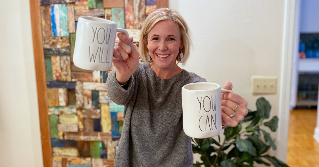 "woman holding up mugs that say ""you can"" and ""you will"""
