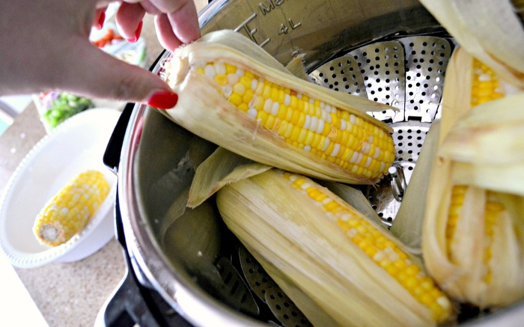 corn on the cob in a steaming basket