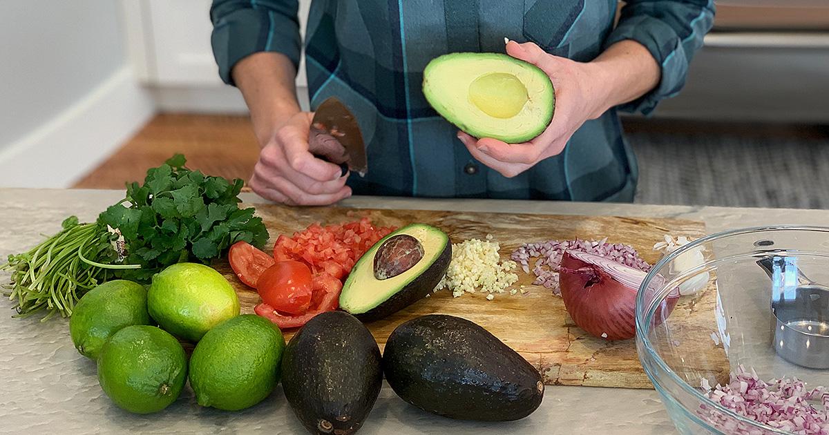 preparing vegetables for the keto guacamole recipe
